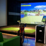 Image of golf bag in front of X-Golf screen with floaties