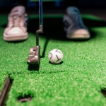 Image of person about to putt at X-Golf Fort Collins