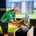 Image of man fiddling with X-Golf computer