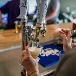 Image of Modelo beer being poured on tap